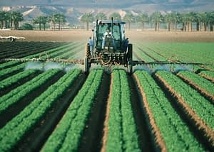 88 days of farm work - Green tractor ploughing a field