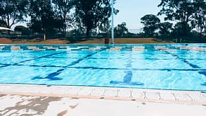 88 days of farm work - Image of people swimming in a public swimming pool