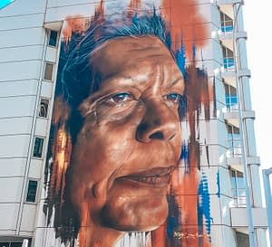 Portrait of an aboriginal woman, Jenny Munro painted onto the side of a large building