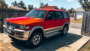 88 days of farm work - Image of red 4x4 car