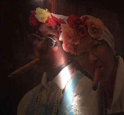 Image of 2 cuban women smoking cigar