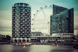 East Melbourne -  iconic building with tiered layers and a large observation wheel - UltimateGuide To Melbourne