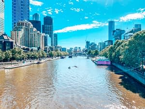 Yarra River Melbourne - Image from the river of large skyscrapers on both banks - Ultimate Guide To Melbourne