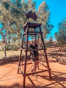 Erldunda Roadhouse - Sarah standing in the middle of Australia statue