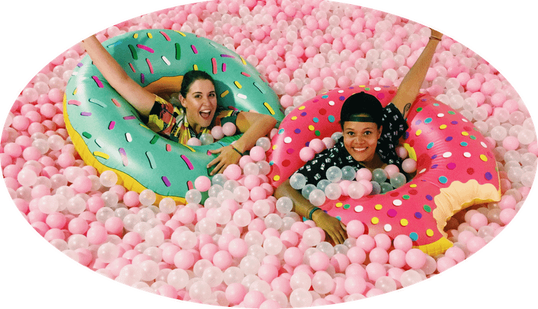 Cloud Walks Creators - Marlie and Sarah in a pink ball pit