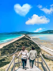 Bruny Island Tasmania - Image of Marlie & Sarah overlooking a long strip of land with two shorelines on either side - Things To Do In Tasmania