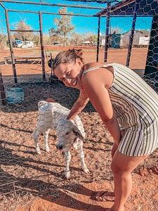 Banka Banka Station - Sarah stroking a baby calf