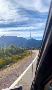 99 bends road Tasmania - Image of mountain range taken from the window of a car -  Lap of Tasmania