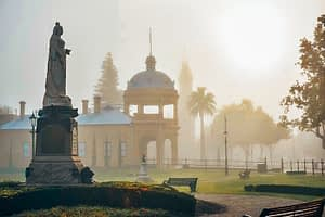 Bendigo - Image of park with Queen Victoria statue and domed palace building