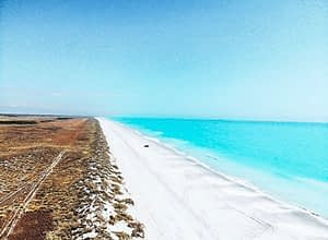 Eighty Mile Beach, Western Australia - Birdseye view of bright blue coast line and white sand