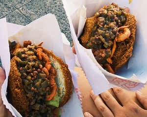 Acaraje Food - Fried buns filled with flavoured shrimps and beans - Things to Do in Salvador Brazil