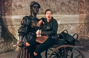 A lady posing with a statue of Molly Malone