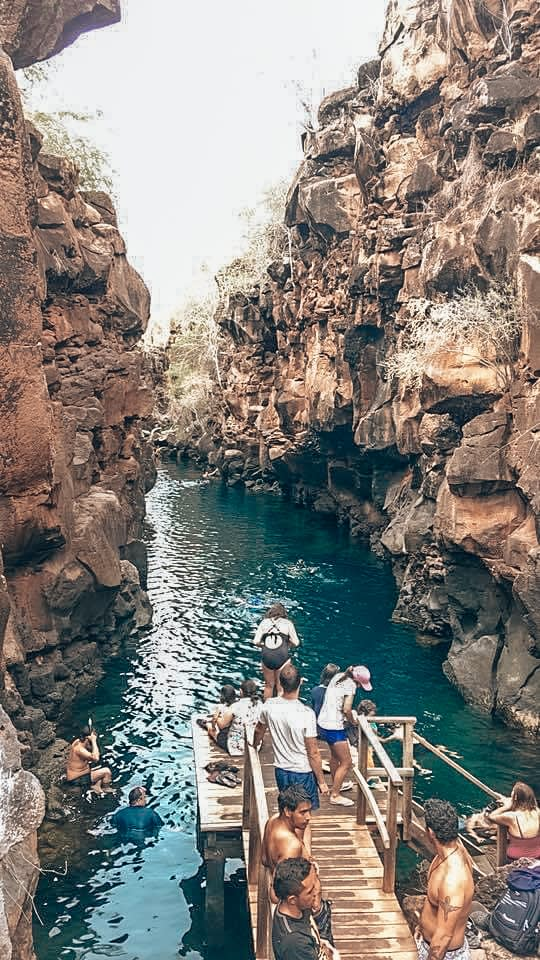 Bright blue watering hole in between two cliff gorges