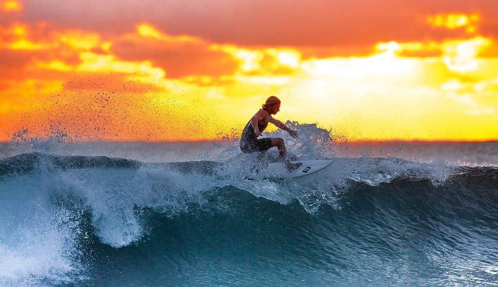 Surfer riding a wave - Great Ocean Rod Recommended Stops