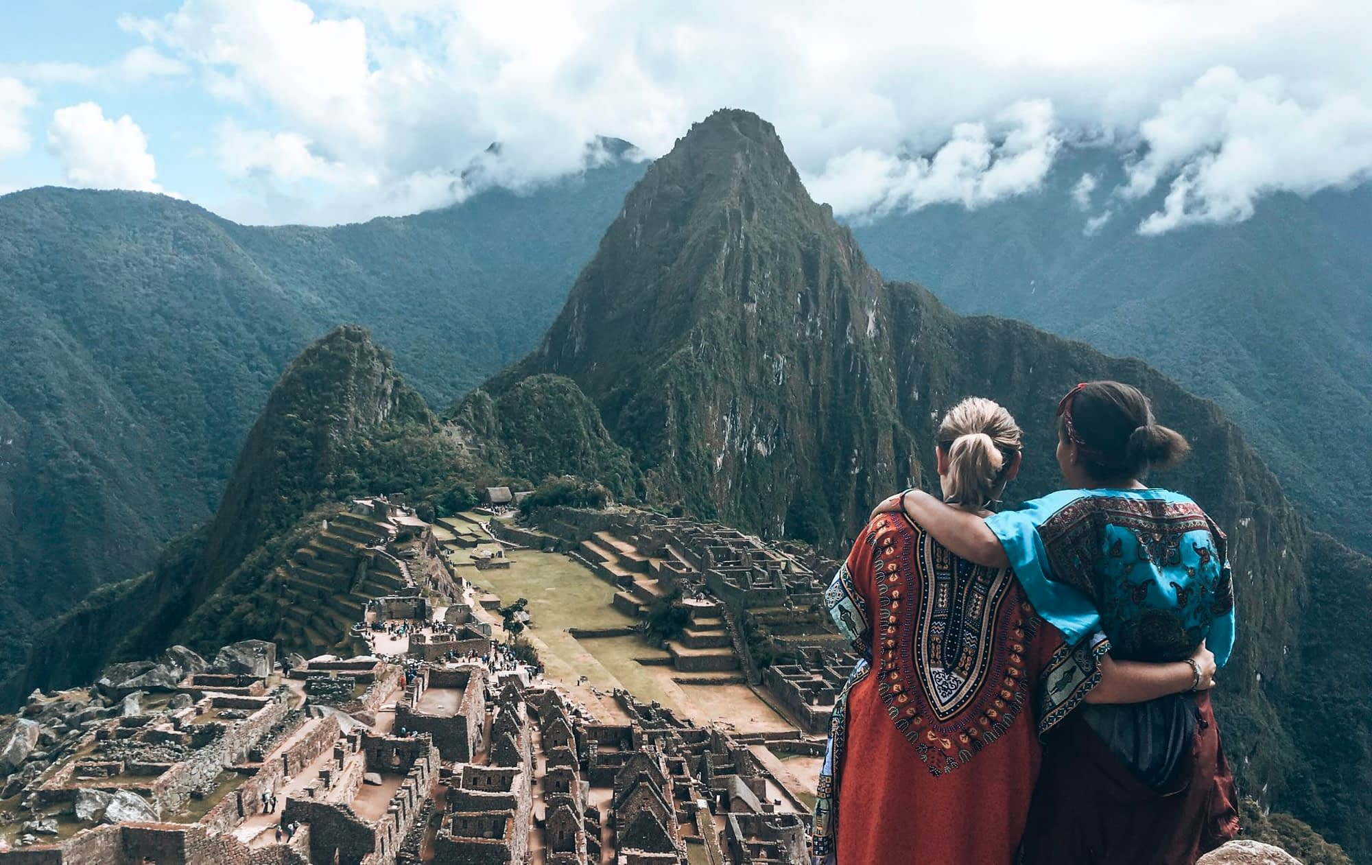 Two girls looking out over Machu Picchu
