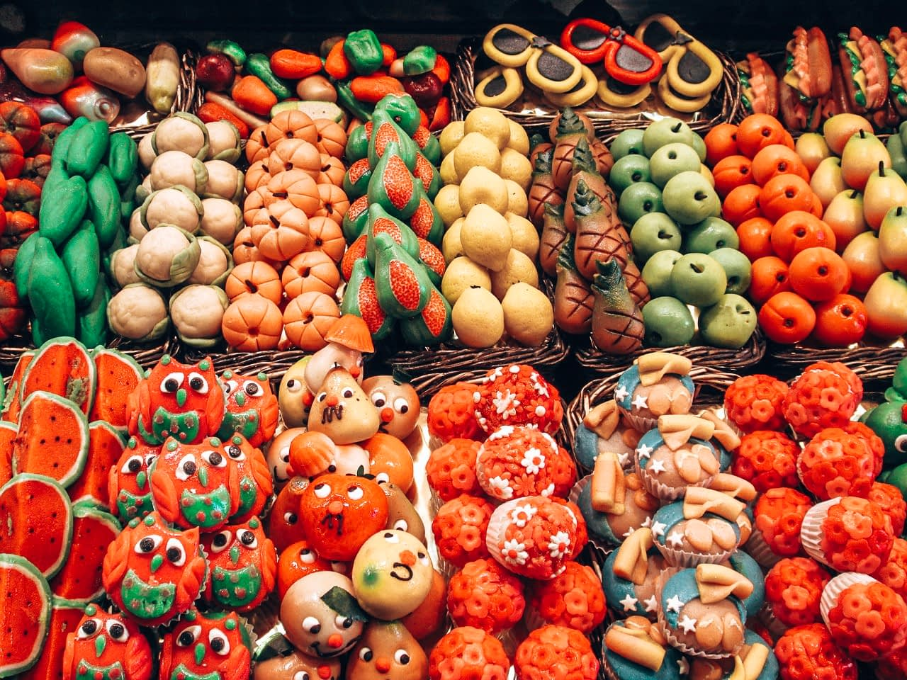A Full Day in Barcelona - Picture of sweets shaped and painted like fruits and vegetables in a market