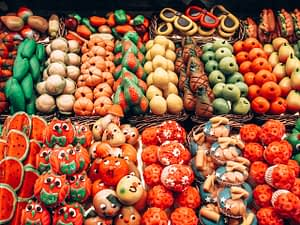 Picture of sweets shaped and painted like fruits and vegetables in a market