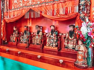 Darwin Chinese Temple - Chinese figurines in a temple display