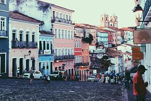 Pelourinho District Salvador Brazil. Image of cobbled street surrounded by large pastel coloured buildings.