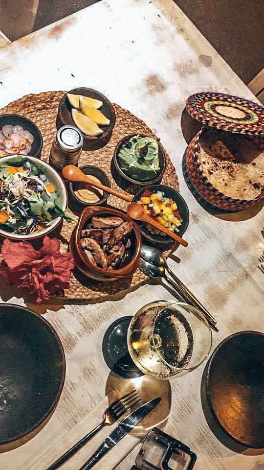Table filled with small bowls of food