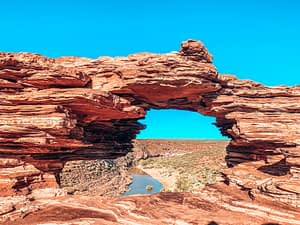 Natures window - Kalbarri National Park. A stone formed with a large hole, representing a window overlooking a gorge below.
