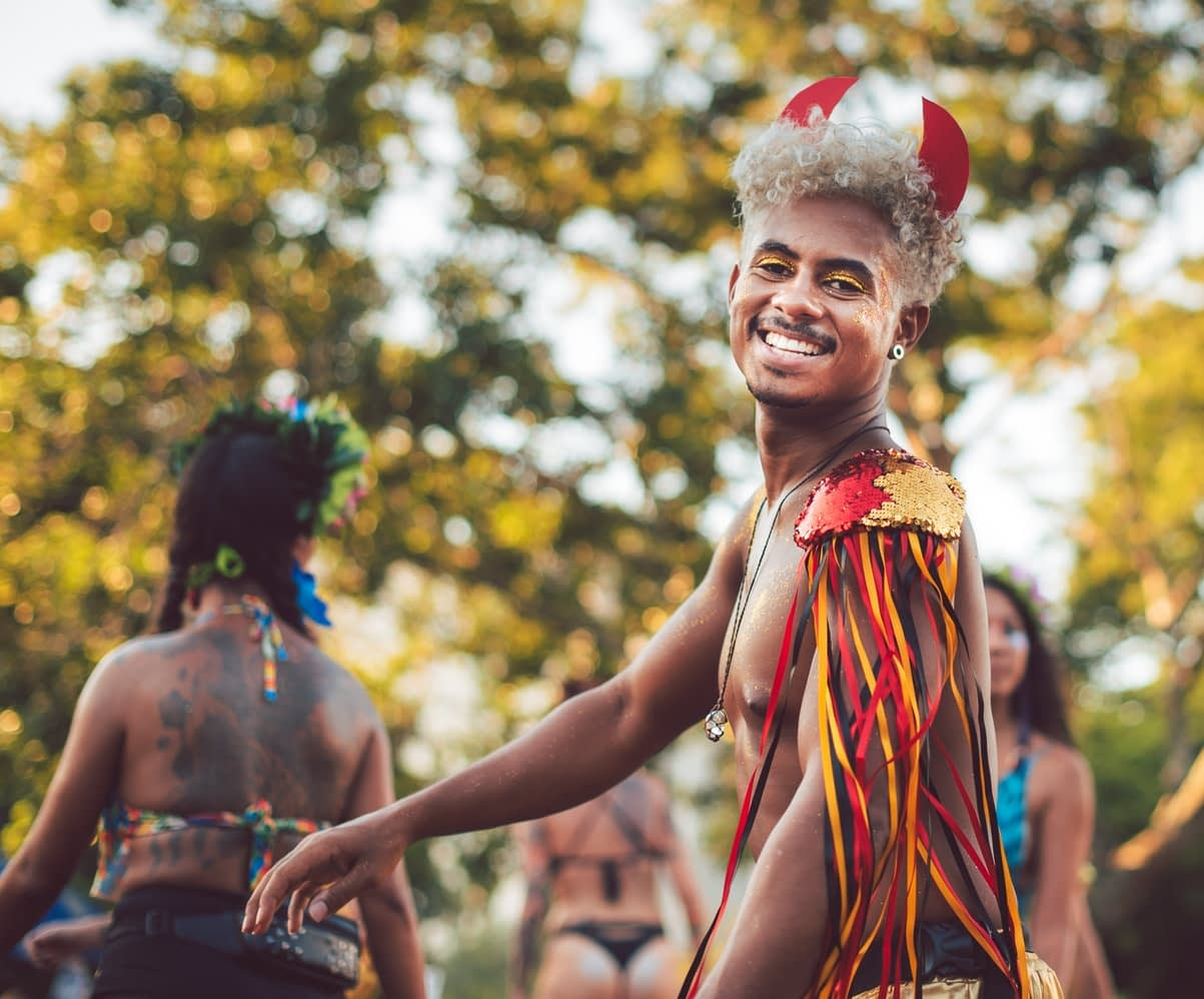 Complete Guide to Rio Carnival - Brazilian Boy Dressed in Carnival Costume with Blonde Afro Hair
