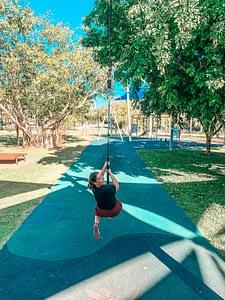 Darwin Bicentennial Park - Image of girl on a zip wire