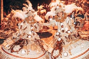 Rio Carnival Dress - A group dressed in Gold, Rustic Red and Cream tones in large brimmed dresses and head dresses