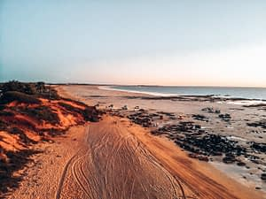 Broome - Birdseye image of an empty beach during sunset