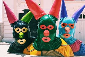 Carnival Museum - Statue of three heads covered with colourful face masks - Things to Do in Salvador Brazil