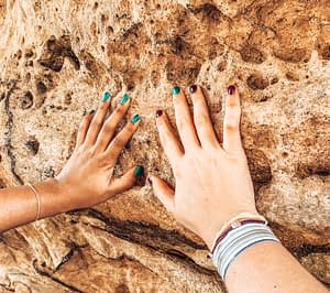 Two hands touching iconic rock formation in Blue Mountains, Sydney