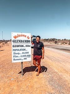 Glendambo welcome sign stating 2,000,000 flies and 30 humans live in Glendambo
