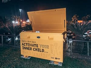 """Darwin - Activate your inner child. Image of large yellow bow with text """"Activate Your Inner Child"""""""