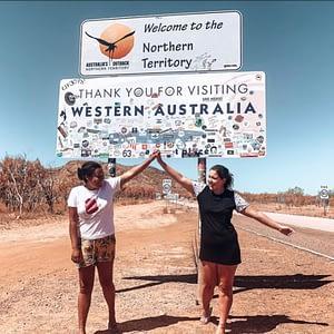 Western Australia border crossing - Two girls posing next to the Western Australia - Northern Territory border sign