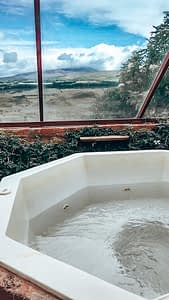 Cotopaxi Secret Garden - Image from a hot tub overlooking large volcano ahead - Cotopaxi Day Trip