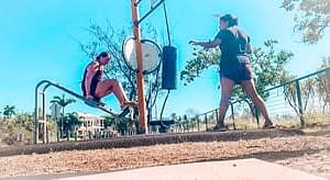 Darwin - Exercise parks. Two girls working out on an outdoor exercise station