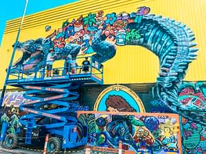 Darwin Street Art Festival - Image of artists painting giant multicoloured crocodile