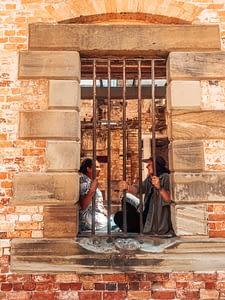 Port Arthur, Tasmania - Marlie & Sarah Posing Behind Bar inside Port Arthur Prison - Lap of Tasmania
